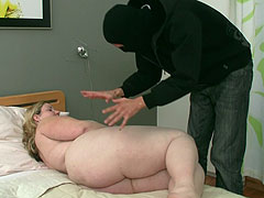 He breaks into her house wearing a mask and then fucks the fat chick before cumming