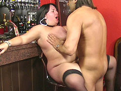 Chubby brunette barmaid in sexy nylons hooks up with a client right at work