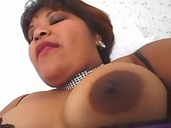 Chubby busty woman dildoing herself