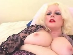 Glamour plump lady using black toy